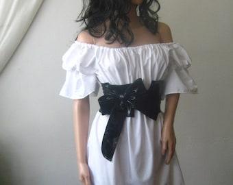 ladies elegant white mini dress or tunic with black elasticated belt.