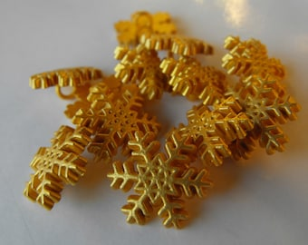 "18 Gold Painted Snowflake Shanked Buttons Size 11/16""."