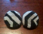 Leather and fabric studs pierced earrings..