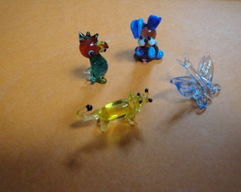 Hand Blown Art Glass Figurine. Four Pack