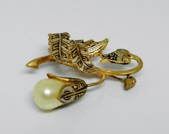 Vintage Damascene Floral Brooch With A Simulated Pearl