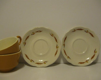 Homer Laughlin saucers and cups set of 2 vintage coffee mugs