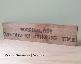 Working out cuts into my drinking time.. -  Wood Sign Burned Quote