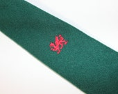 vintage 1980's Men's narrow wool neck tie. Green Flannel with embroidered Griffon in Red. Wales. Made in UK