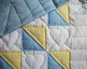 Blue, white and yellow baby quilt