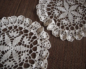 A set of two crochet doilies