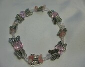 Silvery butterfly and pink crystal bracelet.