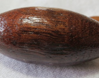 """Large polished wooden, dark brown toggle button. 1.5"""" ins tall, barrel shaped. Lovely grain and patina. WCKG(mem)14.5-12.3."""