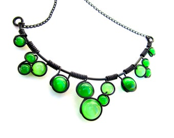 Wire wrapped necklace with bright green cat's eye beads, black wire and adjustable chain
