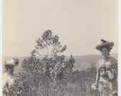Vintage/Antique beautiful photo of two women in dresses and hat picking wild flowers