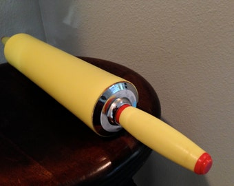Yellow rolling pin red trim metal and plastic classic kitchen look