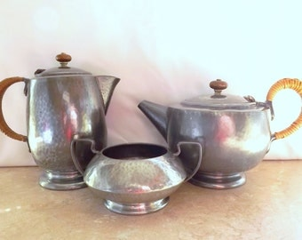 Tudric pewter ware - teapot, coffee pot and sugar bowl, hammered pewter
