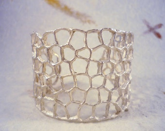 Pixel6. Silver bracelet with organic forms and texture.