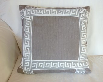 Gray pillow cover with gray and white Greek Key trim