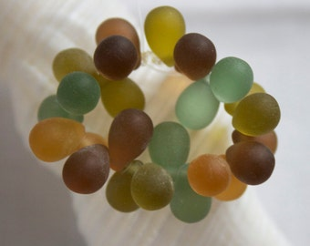 9mm . Czech glass carved drops . matte frosted umber amber celadon sage olive green sea glass . 25 beads