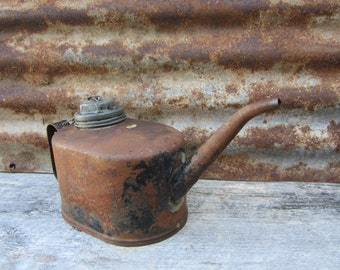 how to clean rusted antique oil cans