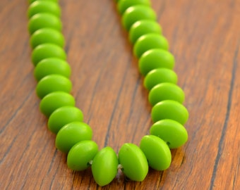 Resin Beads 7 x 10mm Small UFO shape solid lime green 1 x strand of approx 60