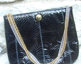Sleek Snakeskin Black Chain bag Designed by Ruth Saltz