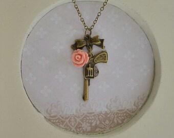 Pistol & Petals Antique Brass Necklace