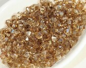 Czech Faceted Bicone Beads 4mm Machine Cut Crystal (50) Beige Topaz AB