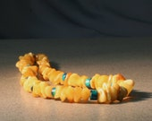 Amber necklace of butterscotch and handmade ceramic beads