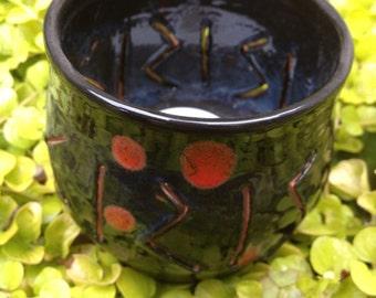 Black and red speckled tea light candle holder, candle holder, cone incense burner