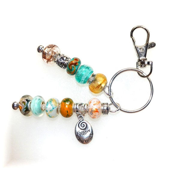 aqua gold beaded key ring with follow your charm