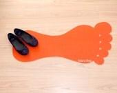 Foot rug silhouette. Modern floor mat with foot shape.