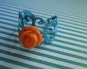 adjustable turquoise filigree ring with orange resin rose