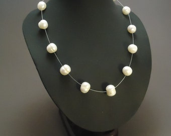 White fresh water pearls on steel wire