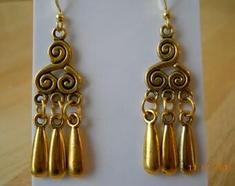 Gold Earrings with Gold Teardrop Dangles.