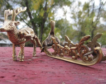 Brass Sled and Rain Deer :)SALE Use Coupon Code CLEARINGOUT25 Must Be used at check out can not change after paying for item.