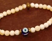 Beaded Stretch Bracelet With White Calcite and Evil Eye Bead