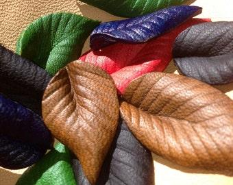 """One 1"""" leather tea leaf."""