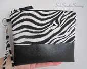 Zebra Faux Leather Wristlet, Zipper Closure,  7 x 8.5 inches, Will Fit iPhone 7 Plus & 6 Plus, 2  Interior Pockets, Fully Lined with Satin