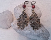 Oak Leaf Drop Rustic Boho Earrings in Antiqued Bronze with Red Bead