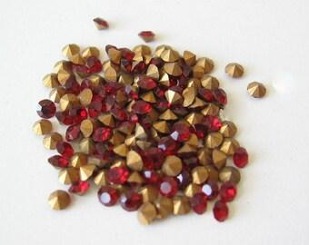 50 Swarovski Siam red crystal rhinestone chaton with gold foil. 2.4mm