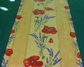 Cotton Coated  Runner  : Poppies in a yellow backround .