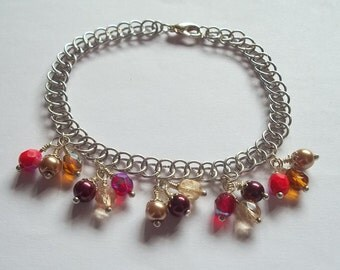 Wine and gold themed chainmaille bracelet.