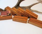 Seven wood business card holders, custom made from roasted curly maple.