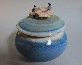 decorative porcelain jar with shell handle