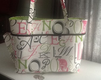 Large Diaper/Tote bag with lots of pockets inside and out including exterior bottle pocket