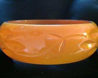 Vintage Lucite Orange Carved Bangle Bracelet