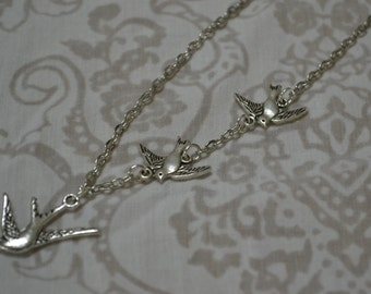 3 flying birds charm necklace
