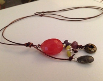 """Long lariat necklace with adjustable leather to 36"""" long. Large """"cherry"""" Quartz, labradorite, and jade baubles."""