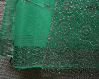 Vintage emerald green sari with metallic accents