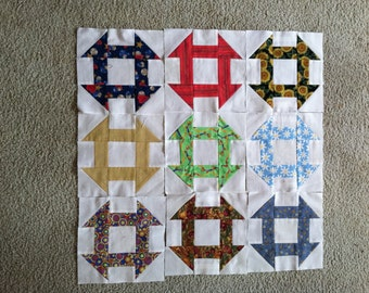 Nine Colorful Churn Dash Quilt Squares