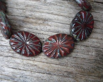 Carved oval red picasso beads, 18x14 red oval beads with picasso finish