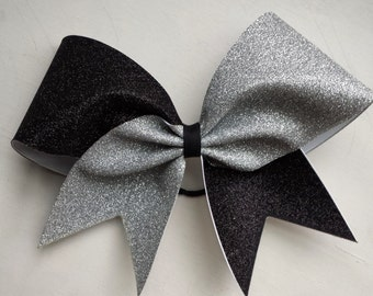 Black and silver glitter cheer bow. Ask about bulk discounts, color and mascot options.