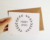 Christmas Card with Hand Lettering Merry Xmas, Wreath Illustration with kraft envelopes - mipluseddesign